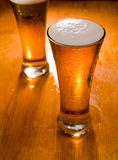 Two beer glasses, focus on first Royalty Free Stock Photography