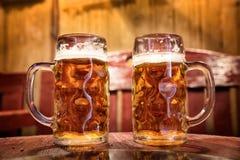 Two beer mugs at the bar Stock Photo