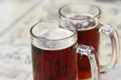Two beer mugs closeup photo Stock Images