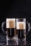 Two beer mugs on table Royalty Free Stock Photo