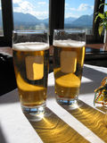 Two Beers. Lagers in the mountains of Salzburg Austria stock photo