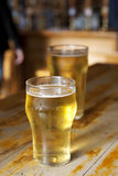 Two beers on a bar Stock Image