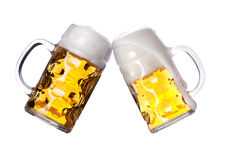 Two beers making a toast. On white backgroound royalty free stock photography