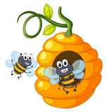 Two bees flying around beehive Royalty Free Stock Image
