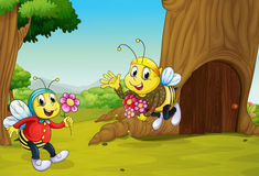 The two bees near a treehouse Stock Images