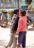 Two beggar indian  child whispering. In  street Royalty Free Stock Photography