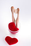Two beige dental brushes in glass cup with red hearts  on white background. Isolated. Love. Valentine day. Stock Images
