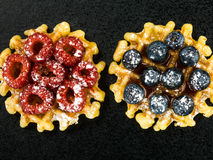 Two Belgian Butter Waffles topped with Fresh Raspberries and Blu Stock Image