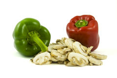 Two bell peppers and sliced champignon mushrooms Royalty Free Stock Photos