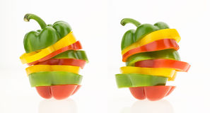 Two bell peppers sliced into colorful rings Royalty Free Stock Images
