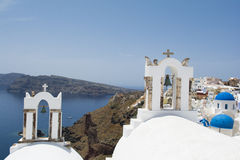 Two bell towers  in Oia village, Santorini island Stock Photography