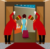 Two bellhops looking at woman leaving Stock Images