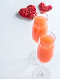 Two bellini cocktails with hearts Royalty Free Stock Photography