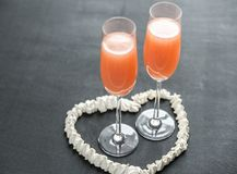 Two bellini cocktails inside of meringue heart Royalty Free Stock Images