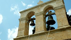 Two bells against the blue sky. Visit to the monasteries and churches of Greece stock footage