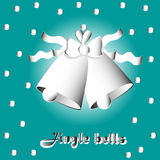 Two bells with bow and ribbon. Vector illustration on a green background Two bells with ribbon bow and snowflake falling confetti or paper applique style Stock Photos