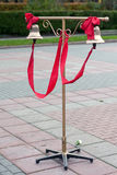 Two bells with red ribbon on the stand for the groom and  bride Stock Photo