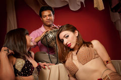 Two Belly Dancers With Indian Man Royalty Free Stock Photo