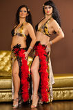 Two belly dancers preforming on stage Royalty Free Stock Photo