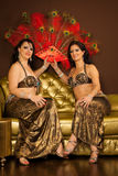 Two belly dancers preforming on stage Stock Image