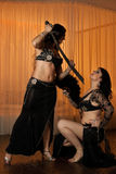 Two belly dancers preforming on stage Royalty Free Stock Photos