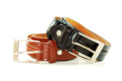 Two belts. The same design but different leather colours. White background Royalty Free Stock Image