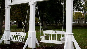 Two bench swing attached to its pillar stock footage
