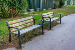Two bench. Of wood and steel on the path Royalty Free Stock Photo