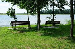 Free Two Benches By The Lake Stock Image - 163486701