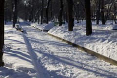Two benches covered with snow. Royalty Free Stock Image