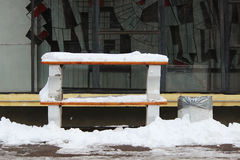 Two benches covered with snow, which stand one on the other. Stock Images