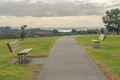 Two benches facing each other. Horizontal photo, photo took in New Zealand, photo is usable on picture post card, calendar, gardening, magazine Stock Photography