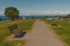 Two benches facing each other with view of the ocean Royalty Free Stock Photography