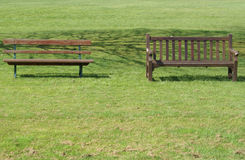 Two benches on the lawn Stock Image