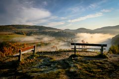 Two Benches in Misty Morning. On the Top of the Hill stock photo