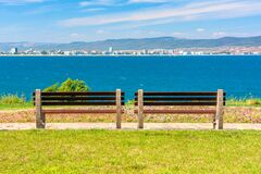 Free Two Benches On The Sunny Beach Shore. Royalty Free Stock Photography - 181591097