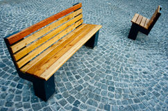 Two benches in a park Stock Images