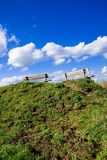 Two benches on top of a hill Stock Photos