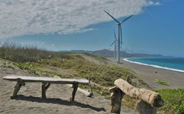 Two Benches with Wind Turbine Farm Royalty Free Stock Images