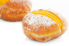 Two Berliner with egg creme over white Royalty Free Stock Images