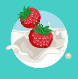 Two berries falling in cream splash Royalty Free Stock Photography