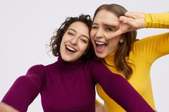 Excited teen girls taking selfie together royalty free stock image