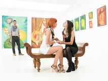 Two best friends in an art gallery Stock Photography