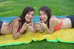 Two best friends in bathing suits Royalty Free Stock Photography