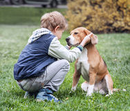Two best friends - boy and his dog Royalty Free Stock Images