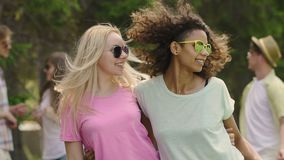 Two best friends dancing, enjoying party with friends in park, summer vacation. Stock footage stock footage