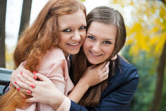 Two best friends embracing Stock Images