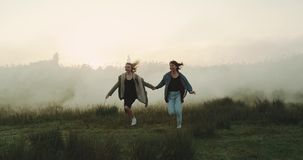 Two best friends having fun in the foggy atmosphere.