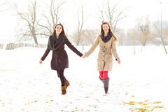Two best friends holding hands and walking Royalty Free Stock Photography