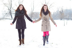 Two best friends holding hands Stock Photo